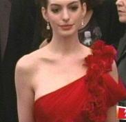 Anne Hathaway red drapey one shoulder hoosefoose