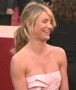 Cameron Diaz rocks the just got done with yoga pony tail with a boring seashell origami thing
