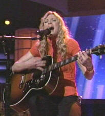 Brooke White rocks the apricot top in honor of Carly Simon's You're So Vain
