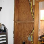The rerouted wiring behind the kitchen wall.
